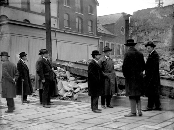 Businessmen inspect the damage in the aftermath of the burning of Cork city centre by crown forces.