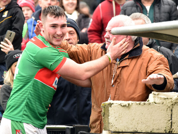 Fr O'Neill's Deccie Dalton celebrates with his father Robbie after the intermediate final. Picture: Eddie O'Hare