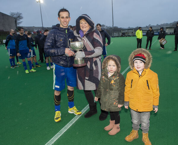 Church of Ireland Captain Phil Byrne receiving the trophy from Sandra Peard O'Driscoll and her grandchildren Erica and Luke Ahern. Picture: Dan Linehan