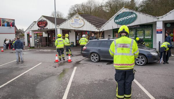 Emergency services pictured at a car park in Ballincollig, Cork where a car crash resulted in structural damage to a number of business premises this afternoon. Pic Daragh Mc Sweeney/Provision