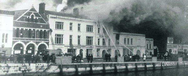 BUILDING ABLAZE: A view from across the River Lee of the firefighters on the St Patrick's Quay side of Scott's complex on February 13, 1965 — fortunately, no firefighters or civilians died that day