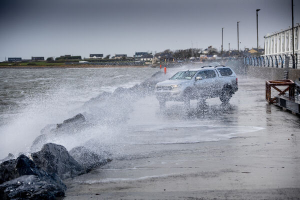 Waves smash against cars at Fenit Marina in Fenit Co Kerry. Pic: Domnick Walsh