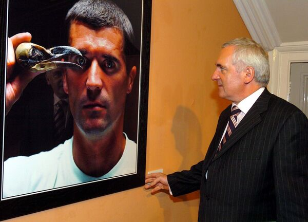 Former Taoiseach Bertie Ahern looking at a portrait of Roy Keane in the Crawford Gallery during the visit of the Cabinet to Cork. Picture: Maurice O'Mahony