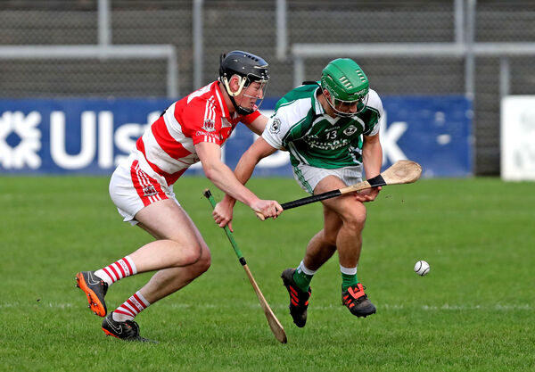 Shane Murphy, Ballincollig, battles Denis Coghlan, Courcey Rovers, in last year's U21 P2 Hurling final. Picture: Jim Coughlan