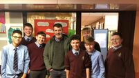 Roy Keane pops into his old school for Christmas