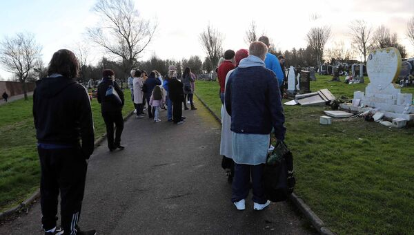 Large numbers of people at the grave yard to check their family graves and inspect the Vandalism.Picture: Jim Coughlan.