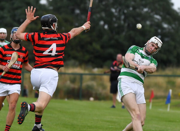 Valley Rovers' Chris O'Leary shoots as Cloyne's David Jermyn closes in. Picture: David Keane.
