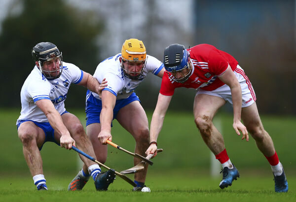 Waterford's Jake Dillon and Kieran Power in action against Cork's Conor Lehane Mandatory Credit ©INPHO/Ken Sutton