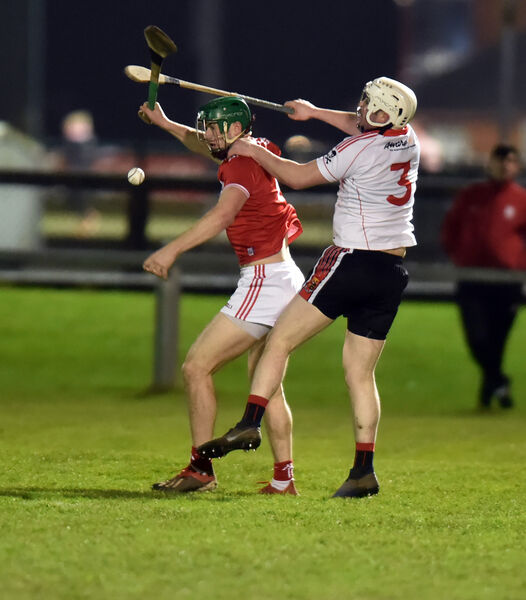 UCC's Eoghan Murphy Cork's Seamus Harnedy tussle for the sliotar during the Canon O'Brien cup at The Mardyke last nightPicture: Eddie O'Hare