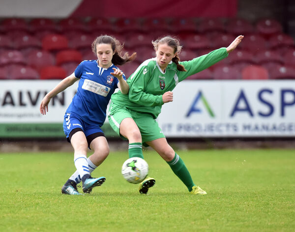 Wilton United's Laura Shine clears from Passage's Eimear Murphy. Picture: Eddie O'Hare