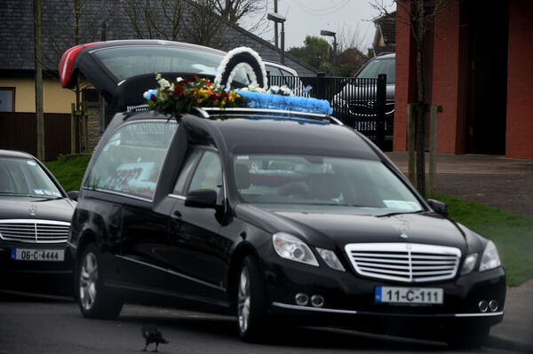 Funeral hearse awaits the remains of Francis (Frankie) Dunne at the church of St Mary's on The Hill, Knocknaheeney, Cork today