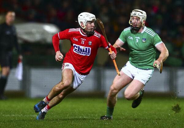 Cork's Luke Meade and Limerick's Cian Lynch, Picture: INPHO/Ken Sutton
