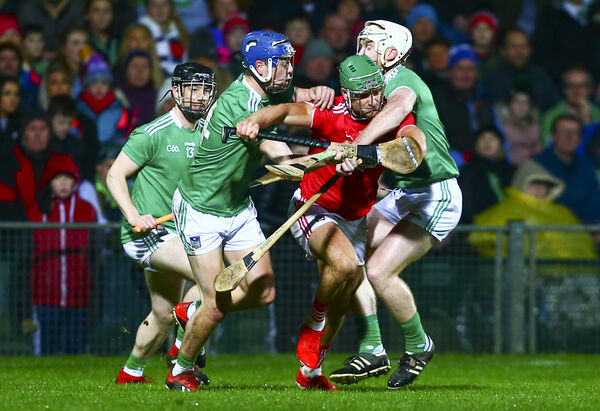Cork's Eoin Cadogan is tackled by Limerick's Cian Lynch and David Reidy. Picture: INPHO/Ken Sutton