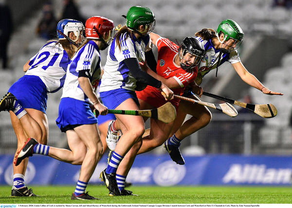 Linda Collins of Cork is tackled by Shona Curran, left and Sibeal Harney of Waterford. Picture: Eóin Noonan/Sportsfile