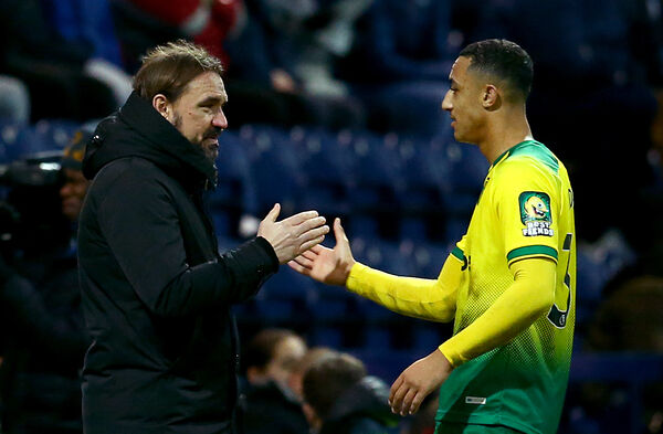 Norwich City's Adam Idah shakes hands with manager Daniel Farke after his substitution during the FA Cup third round match at Deepdale, Preston.