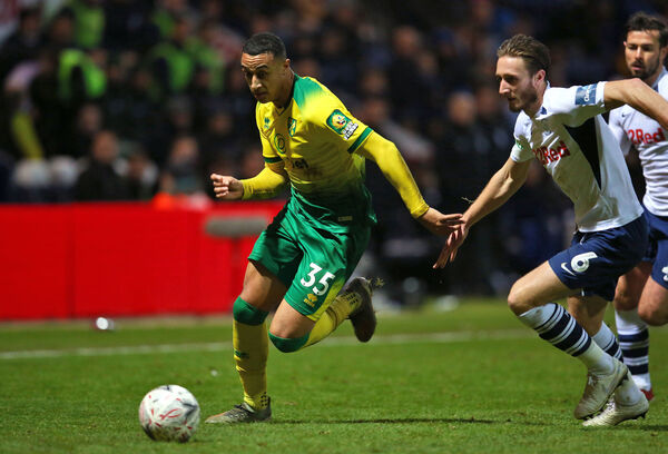 Norwich City's Adam Idah (left) and Preston North End's Ben Davies battle for the ball during the FA Cup third round match at Deepdale, Preston. PA Photo.