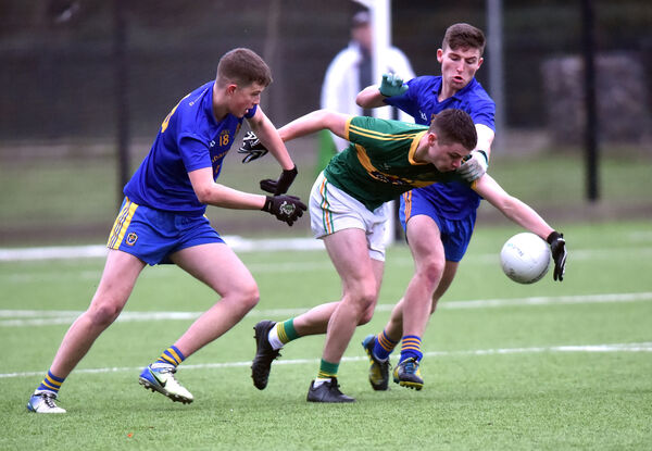 Diarmuid Cormack is tackled by St Finbarr's Shane Dwane and Cathal Crowley. Picture: Eddie O'Hare