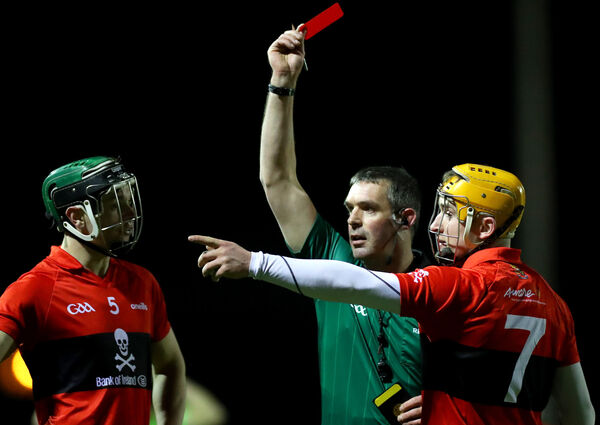 Referee James Owens red cards Niall O'Leary of UCC. Picture: INPHO/James Crombie
