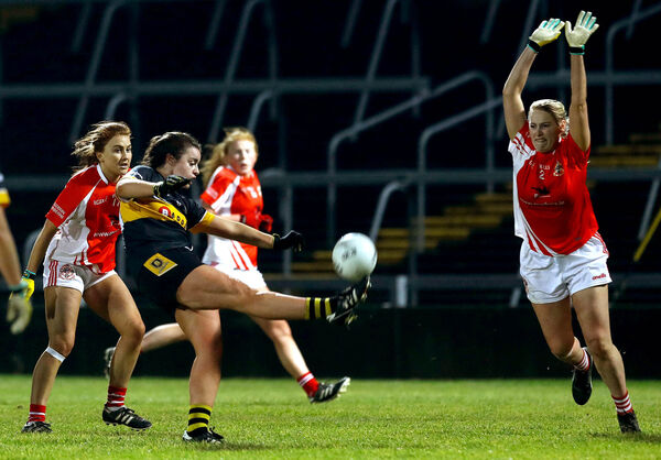 Mourneabbey's Laura Fitzgerald kicks to score the winning pointMandatory Credit ©INPHO/Lorraine O'Sullivan