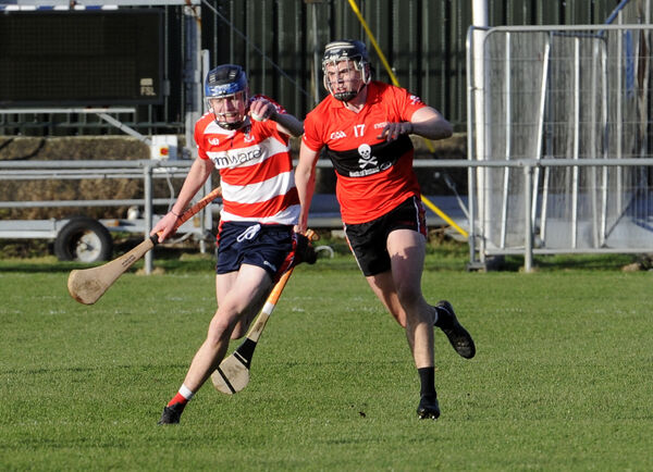 CIT's Cathal O'Carroll keeps a tight grip on the ball against Darragh Fitzgibbon. Picture: Gavin Browne