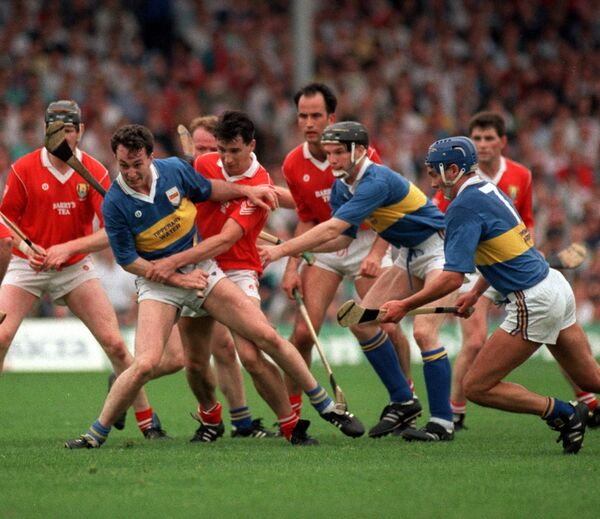 Cork players Kevin Hennessy, Tomás Mulcahy, Mark Foley battle Tipperary's Michael Ryan and Conal Bonnar in 1991.
