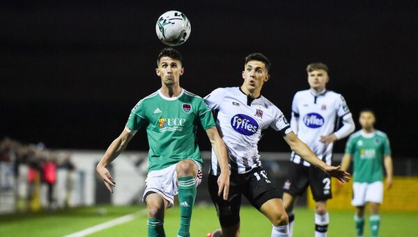 Shane Griffin of Cork City in action against Jamie McGrath of Dundalk. Picture: Ben McShane/Sportsfile