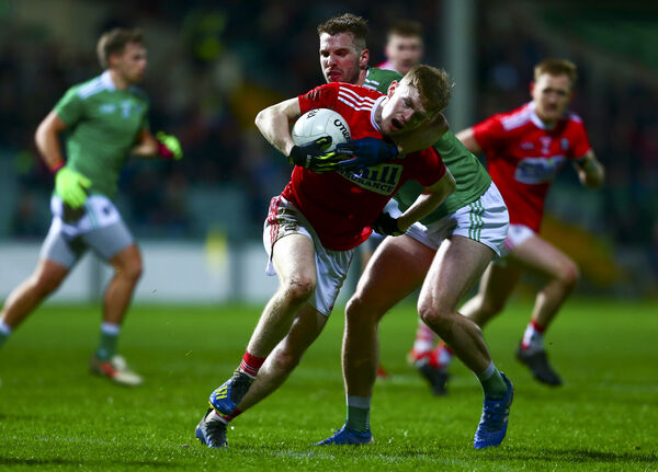 Cork's Paul Ring is tackled by Limerick's Tommy Griffin Mandatory Credit ©INPHO/Ken Sutton