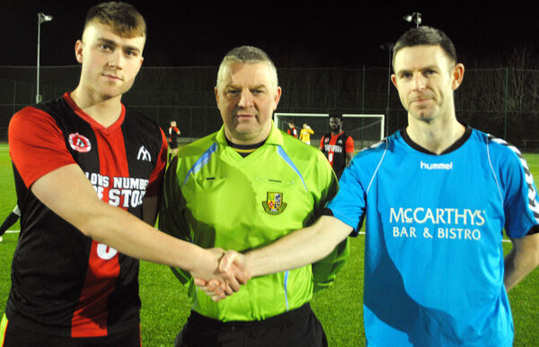 City Wanderers captain Derek Peyton (right) welcomes Buttevant's Adam Finnegan watched by referee Richard Murphy. Picture: Barry Peelo.