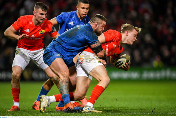 Mike Haley of Munster is tackled by Andrew Porter of Leinster. Picture: Ramsey Cardy/Sportsfile