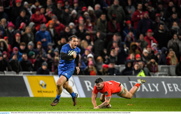 James Lowe of Leinster in action against Sammy Arnold of Munster. Picture: Ramsey Cardy/Sportsfile