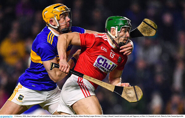 Alan Cadogan of Cork is tackled by Seán O'Brien of Tipperary. Picture: Eóin Noonan/Sportsfile