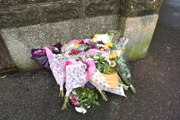 Flowers left outside Castlegreina House on the Boreenmanna Road in Cork where the body of Frankie Dunne was discovered. Picture Dan Linehan