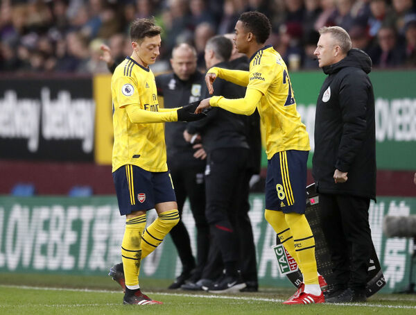 Arsenal's Mesut Ozil (left) is substituted off for Arsenal's Joe Willock. Picture: Martin Rickett/PA Wire.
