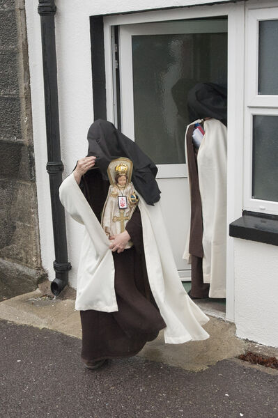 Sr Irene Gibson, Carmelite Nun of the Holy Face of Jesus pictured leaving Skibbereen District Court (carrying a 'Child of Prague' religious statue) and Sr Anne Marie of the Holy Family Carmelite Hermitage, Leap, Co Cork.Pic Daragh Mc Sweeney/Cork Courts