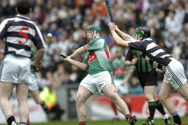 John Flavin, Fr O'Neill's knocking this ball over the bar from John Rogers, Erin's Own. Picture Dan Linehan