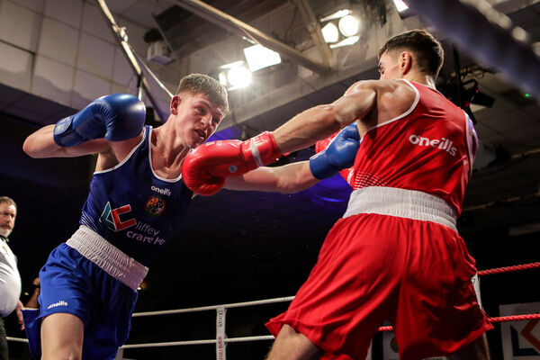 Aidan Walsh (red) battling Callum Walsh (blue). Picture: INPHO/Laszlo Geczo