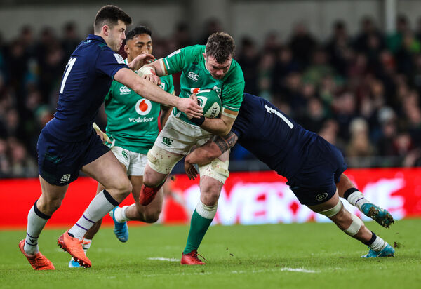 Peter O'Mahony tackled by Scotland's Blair Kinghorn and Rory Sutherland. Picture: INPHO/Billy Stickland