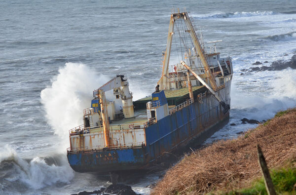 The MV Alva being battered by waves as it lies on the rocks near Ballyanna, Ballycotton. Picture: Howard Crowdy