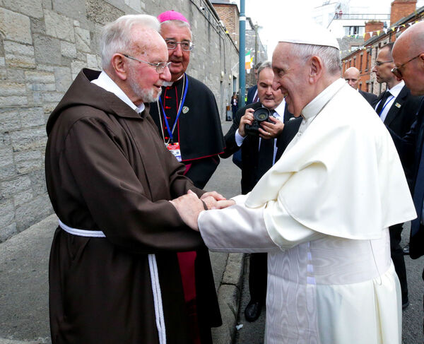 Pope Francis shakes hands with Br Kevin Crowley as he arrives for a visit to the Capuchin Day Centre on Bowe Street in Dublin, as part of his visit to Ireland last year. Photo: PA Wire