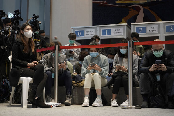 Reporters attend a press conference of Hong Kong Chief Executive Carrie Lam in Hong Kong today. (AP Photo/Kin Cheung)