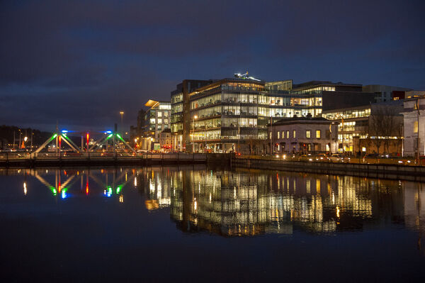 Buildings reflected in the River Lee with high tide expected in the early hours of today. Picture Dan Linehan