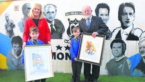 Mural unveiled to famous North Mon alumni
