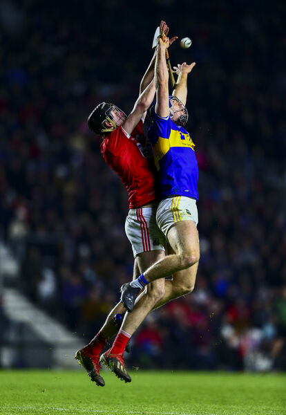 Tipperary's Jason Forde in action against Cork's Robert Downey. Picture: INPHO/Ken Sutton