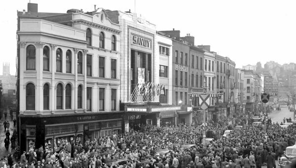 Crowds gather outside the Savoy Cinema