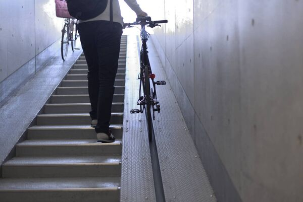 Wheel ramps are commonplace in many UK, European and North American cities and allow cyclists to easily get up steps without having to carry their bikes. Pic: iStock