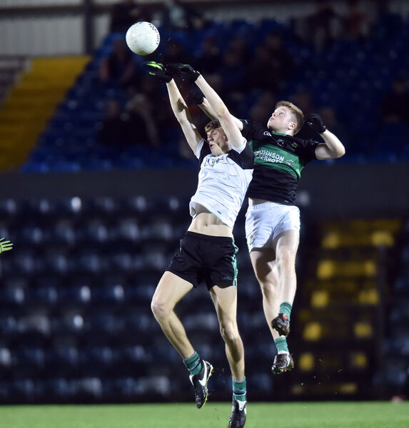 Douglas' Niall Harnett goes high with Nemo Rangers' Patrick Cambell. Picture: Eddie O'Hare