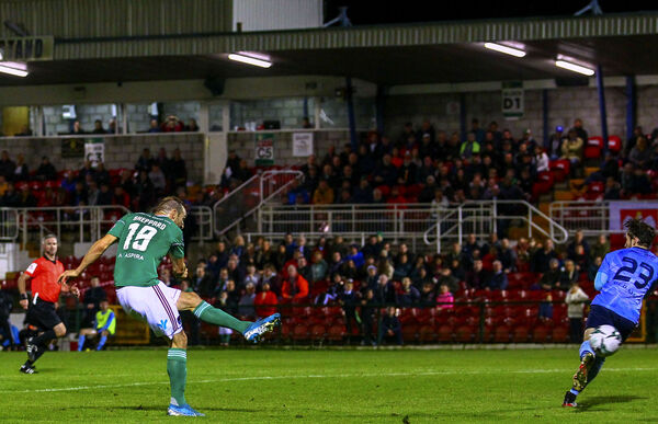 Cork City's Karl Sheppard shoots to score at the Cross on Friday night. Picture: INPHO/Ken Sutton