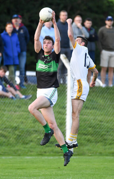 Nemo Rangers midfielder James O'Donovan makes a fine catch under pressure from Bandon's Eoghan O'Donovan. Picture: David Keane.
