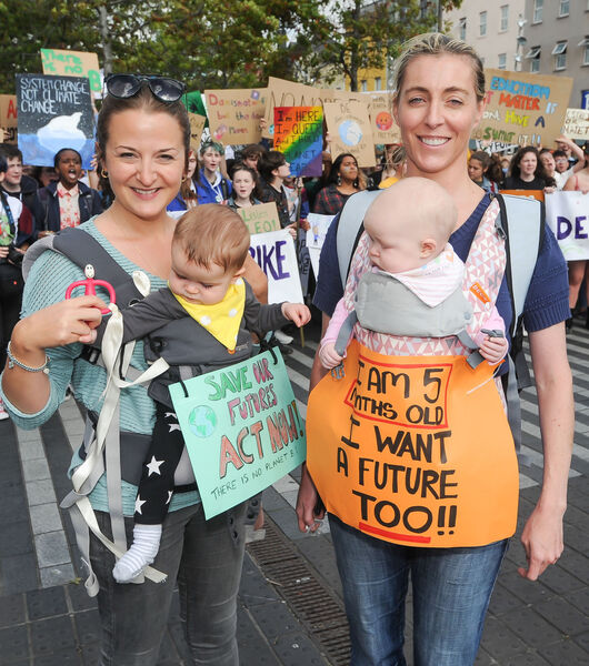 Naomi O'Donovan from Turner's Cross and seven-month-old Indie along with Dearbhaile Collins from Inniscarra and five-month-old Fiadh, taking part in the Cork Climate Strike rally on Grand Parade. Picture: David Keane.