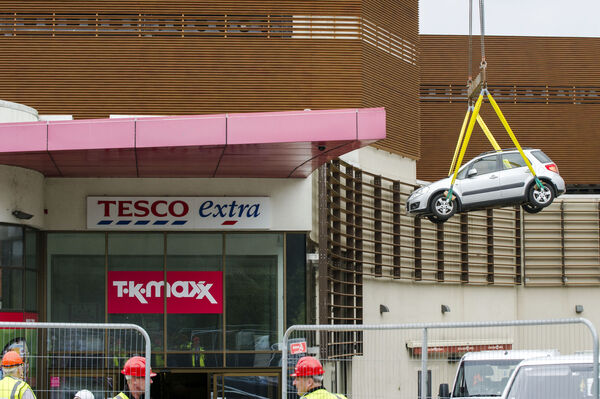 Cars are removed by crane from Douglas Village Shopping Centre, Cork following an accidental fire which severely damaged the multi-storey car park.Pic Daragh Mc Sweeney/Provision